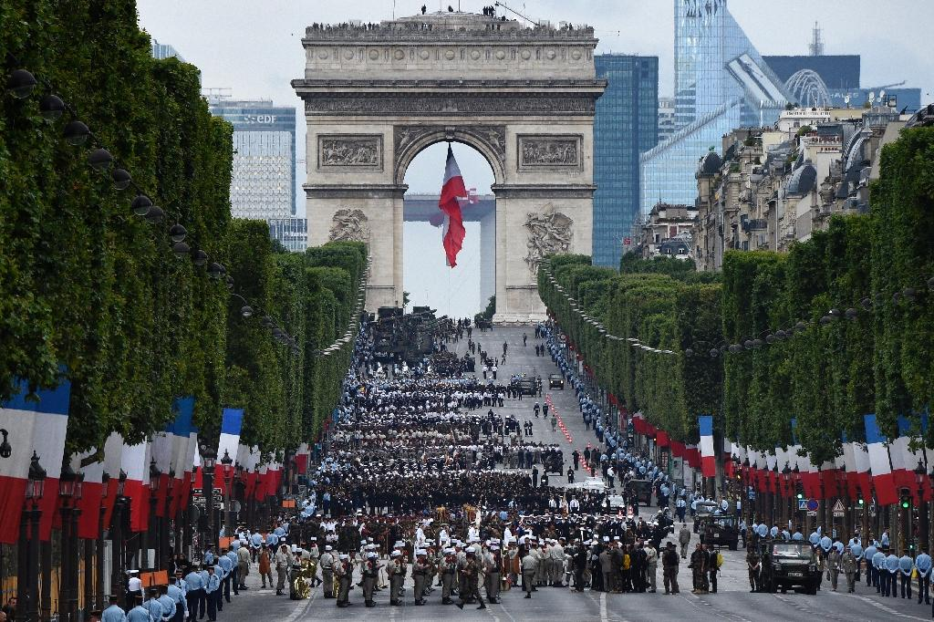 The Champs Elysees has long been a magnet for Parisians and tourists alike, and the site of celebrations like the annual Bastille Day military parade (AFP Photo/DOMINIQUE FAGET                     )