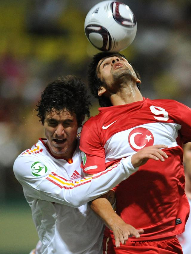 Jose Gomez (L) of Spain vies for the ball with Muhammet Demir (R) of Turkey during football final tournament of UEFA European Under-19 Championship 2010/2011 in Chiajna village next to Bucharest July 26, 2011. AFP PHOTO/DANIEL MIHAILESCU (Photo credit should read DANIEL MIHAILESCU/AFP/Getty Images)