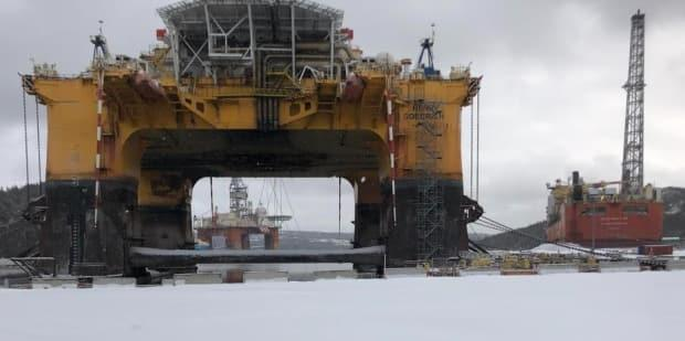 The Bull Arm site in Trinity Bay has become a temporary boneyard for the Newfoundland and Labrador oil and gas industry. In the foreground is the Henry Goodrich drill rig, which has a long history in the offshore, while the West Aquarius is in the background. The Terra Nova FPSO, right, has not produced oil since late 2019. (Submitted/Name Withheld - image credit)