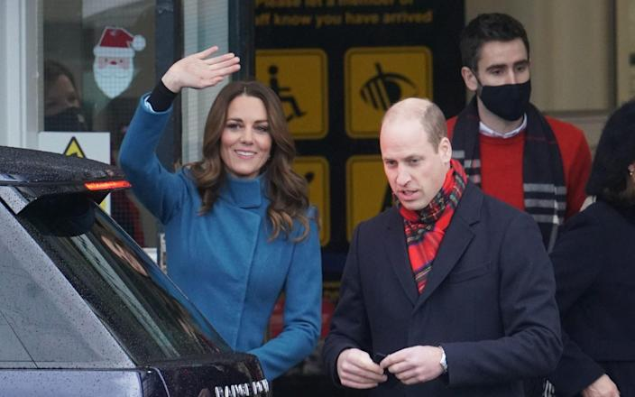 The Duke and Duchess of Cambridge with Christian Jones in the background, pictured in December 2020. - Owen Humphreys/PA