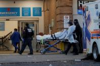 FILE PHOTO: A patient arrives outside Maimonides Medical Center in Brooklyn