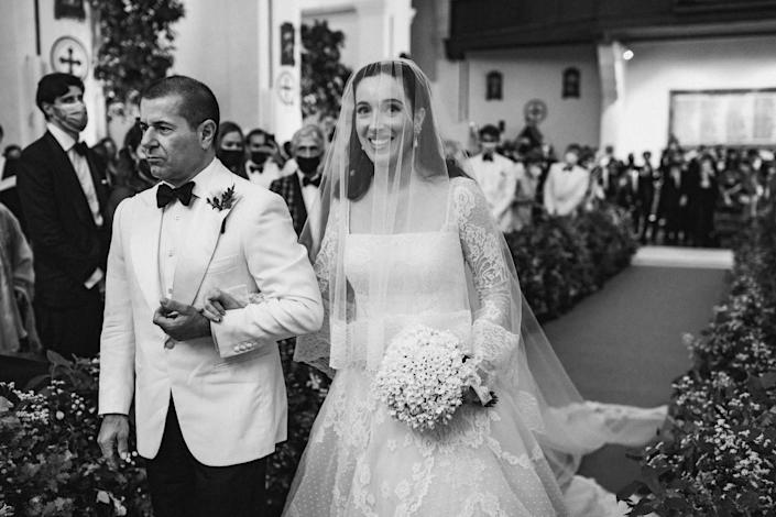 """My father walking me down the aisle. I remember my mom asking him """"Why are you looking so serious, shouldn't you smile?"""" and he just responds """"No, this is a serious moment!"""" I was so overwhelmed with joy. I couldn't stop looking everywhere to take it all in."""