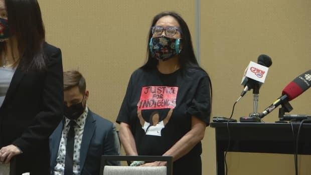 Debbie Baptiste, Colten Boushie's mother, stands at a news conference Monday to address the Civilian Review and Complaints Commission's finding of racial discrimination by the Saskatchewan RCMP.   (CBC - image credit)