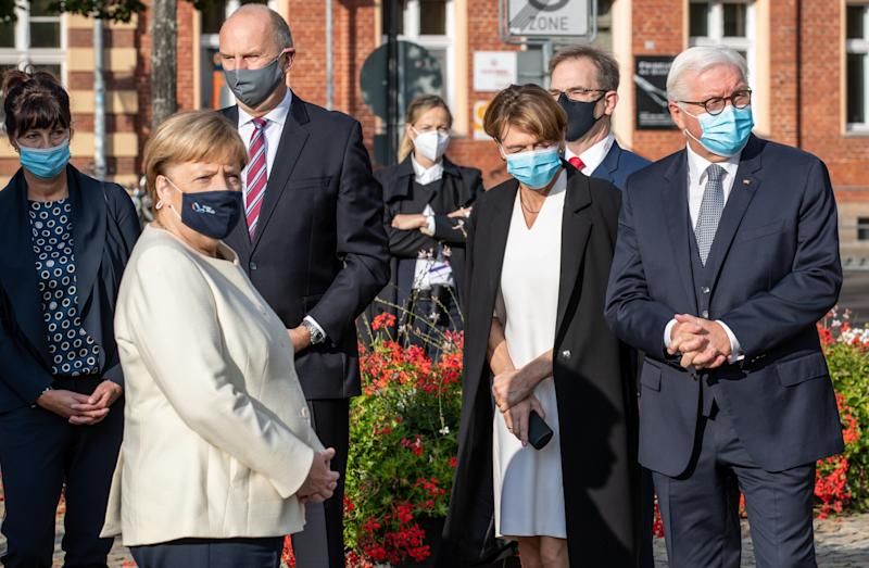 BERLIN, GERMANY - OCTOBER 03: German President Frank-Walter Steinmeier, arrives with his wife Elke Buendenbender, German Chancellor Angela Merkel and Dietmar Woidke, President of the Federal Council, with his wife Susanne Woidke during an Ecumenical church service to mark the 30th anniversary of German reunification on October 03, 2020 in Potsdam, Germany. On October 3, 1990, following the fall of the Berlin Wall and the end of the Cold War a year earlier, West Germany and East Germany merged into modern Germany. (Photo by Andreas Gora - Pool/Getty Images)