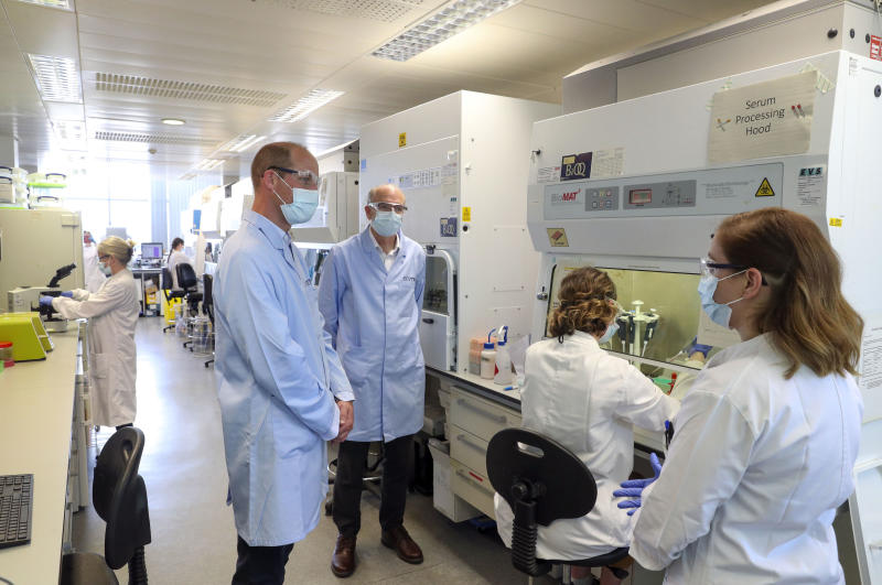 EMBARGOED: not for publication before 2200 BST Wednesday June 24, 2020. The Duke of Cambridge wears a mask as he meets scientists, including Christina Dold (right), during a visit to the manufacturing laboratory where a vaccine against COVID-19 has been produced at the Oxford Vaccine Group's facility at the Churchill Hospital in Oxford.