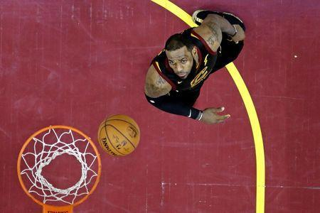Jun 8, 2018; Cleveland, OH, USA; Cleveland Cavaliers forward LeBron James (23) watches a shot during the fourth quarter against the Golden State Warriors in game four of the 2018 NBA Finals at Quicken Loans Arena. Mandatory Credit: Carlos Osorio/pool photo-USA TODAY Sports