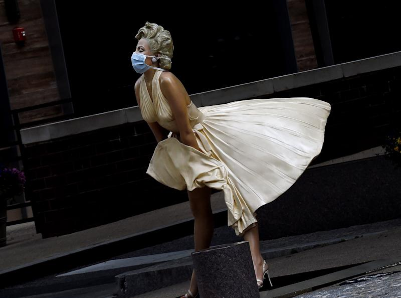 """The """"Forever Marilyn"""" statue by Seward Johnson at National Harbor in Maryland wears a mask. (Photo: Getty Images)"""