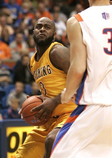 Wyoming's Leonard Washington (0) goes up for a shot against Boise State's Anthony Drmic (3) during the first half of an NCAA college basketball game, Saturday, Feb. 9, 2013, in Boise, Idaho. (AP Photo/Matt Cilley)