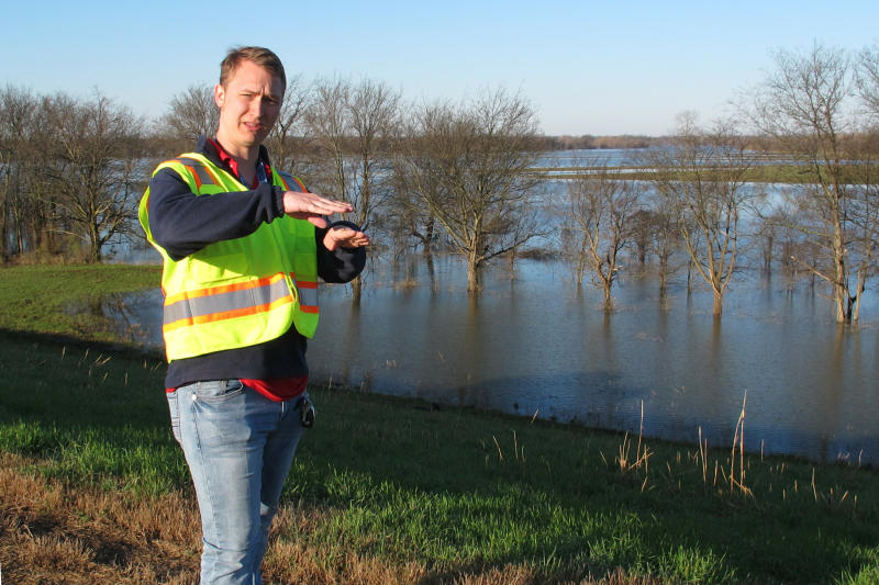 Cody Isbell, a geotechnical engineer with the U.S. Army Corps of Engineers, speaks with a reporter about flooding protection along the Ensley levee near the Mississippi River in Memphis, Tenn., on Thursday, March 21, 2019. (AP Photo/Adrian Sainz)