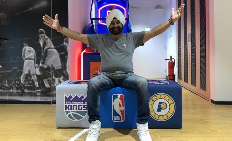 Nav Bhatia poses at the NBA India Office in Mumbai during the NBA India Games in 2019 between Sacramento Kings and Indiana Pacers. Image courtesy: NBA