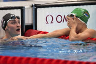 Tatjana Schoenmaker, right, of South Africa, celebrates after her women's 200-meter breaststroke semifinal as Annie Lazor, of the United States, watches at the 2020 Summer Olympics, Thursday, July 29, 2021, in Tokyo, Japan. (AP Photo/Matthias Schrader)