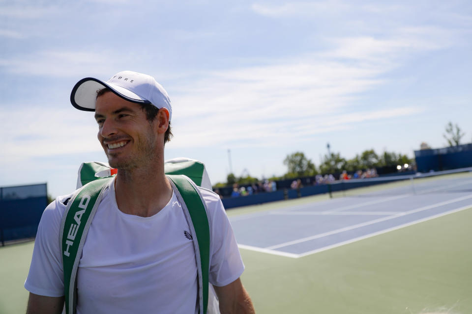 Andy Murray, of Britain, smiles after practice at the Western & Southern Open tennis tournament, Sunday, Sunday, Aug. 11, 2019, in Mason, Ohio. (AP Photo/John Minchillo)