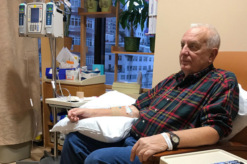 In this Dec. 11, 2017 photo provided by Anna Carlstrand, her husband, Richard, receives the first of 20 Keytruda infusions at Memorial Sloan Kettering Cancer Center in New York. Carlstrand, 76, of Long Key, Florida, underwent the immunotherapy treatment for mesothelioma, an aggressive cancer of the lining of the lungs, and is now in remission. Results on his and other cases were discussed Sunday, March 31, 2019, at an American Association for Cancer Research conference in Atlanta. (Anna Carlstrand via AP)