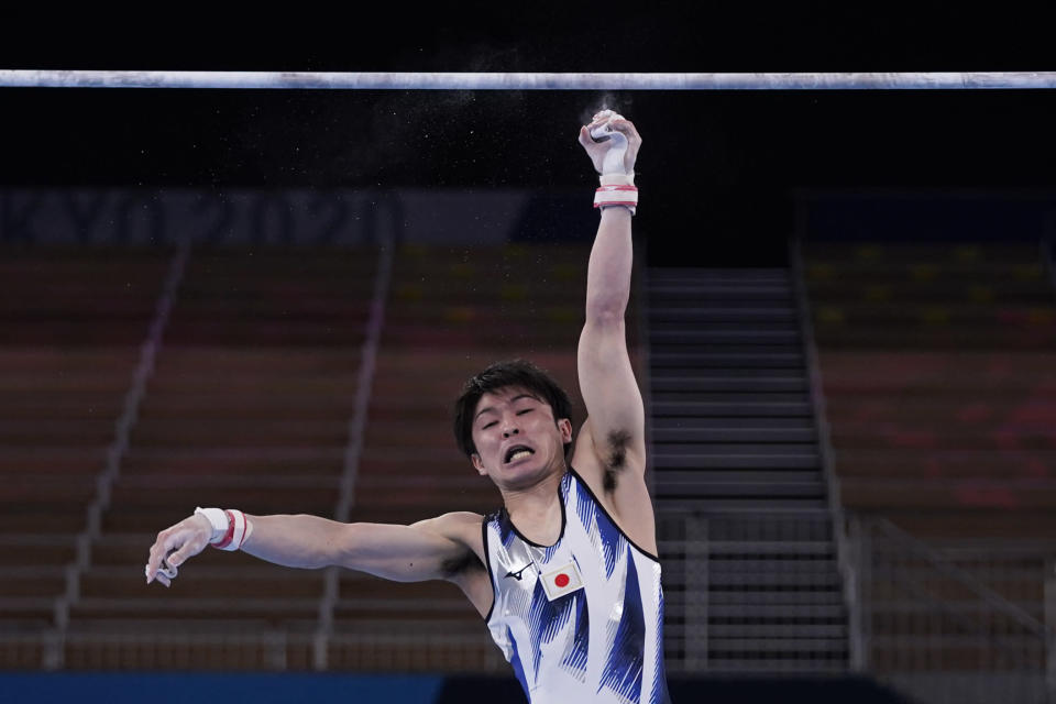 Kohei Uchimura, of Japan, falls from the horizontal bar during the men's artistic gymnastic qualifications at the 2020 Summer Olympics, Saturday, July 24, 2021, in Tokyo. (AP Photo/Gregory Bull)