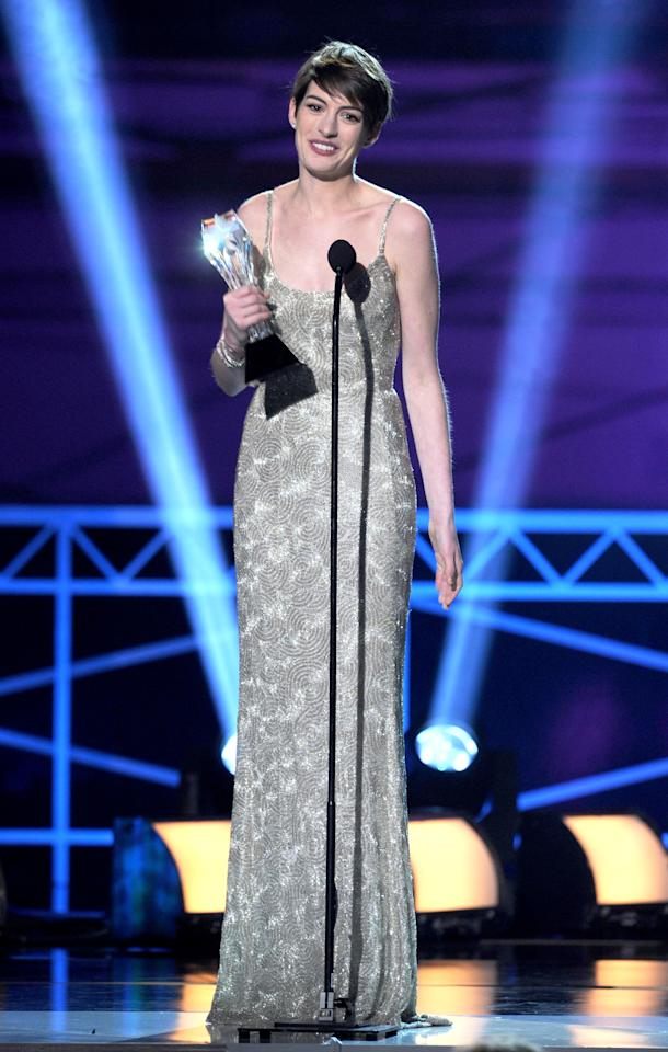 "SANTA MONICA, CA - JANUARY 10:  Actress Anne Hathaway accepts the Best Supporting Actress Award for ""Les Miserables"" onstage at the 18th Annual Critics' Choice Movie Awards held at Barker Hangar on January 10, 2013 in Santa Monica, California.  (Photo by Kevin Winter/Getty Images)"