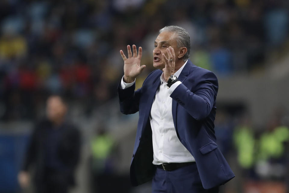Brazil's coach Tite gives instructions from the sideline during a Copa America quarterfinal soccer match against Paraguay at the Arena do Gremio in Porto Alegre, Brazil, Thursday, June 27, 2019. (AP Photo/Andre Penner)