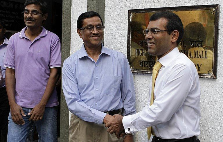 Mohamed Nasheed (right) shakes hands with Indian High Commissioner DM Mulay in Male today. Nasheed sought refuge at the embassy on February 13, straining ties between India and its tiny neighbour, following an arrest warrant that was issued after he failed to attend court for what he called a 'politically motivated' trial