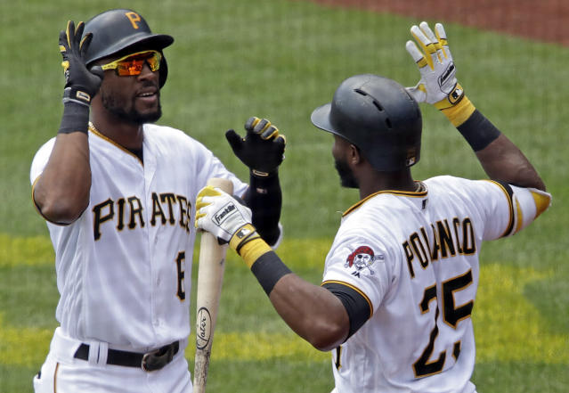 Pittsburgh Pirates' Starling Marte, left, is greeted by Gregory Polanco (25) as he returns to the dugout after hitting a two-run home run off Washington Nationals starting pitcher Gio Gonzalez in the third inning of a baseball game in Pittsburgh, Wednesday, July 11, 2018. (AP Photo/Gene J. Puskar)