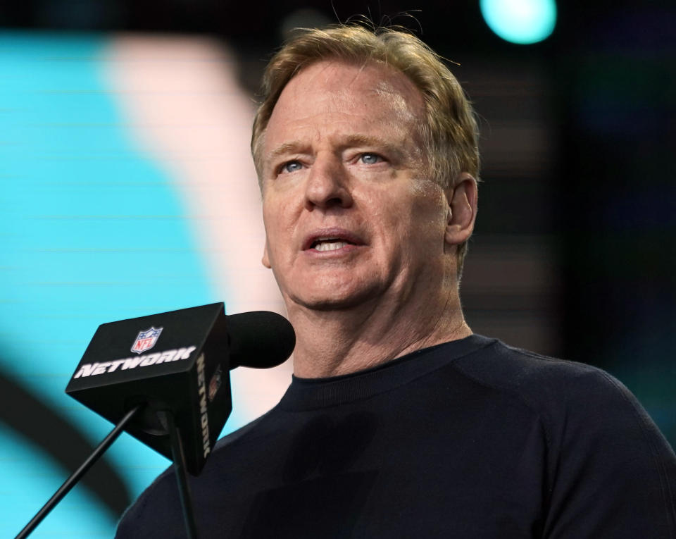 FILE - In this May 1, 2021, file photo, NFL Commissioner Roger Goodell announces the start of the fourth round of the NFL football draft in Cleveland. Jon Gruden is out as coach of the Las Vegas Raiders after emails he sent before being hired in 2018 contained racist, homophobic and misogynistic comments. A person familiar with the decision said Gruden is stepping down after The New York Times reported that Gruden frequently used misogynistic and homophobic language directed at Goodell and others in the NFL. (AP Photo/Tony Dejak, File)