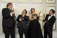 """Phillip Bladh, from left, Carlos Cortes, Michellee Couttolenc and Jaime Baksht, winners of the award for best sound for """"Sound of Metal,"""" pose in the press room at the Oscars on Sunday, April 25, 2021, at Union Station in Los Angeles. (AP Photo/Chris Pizzello, Pool)"""