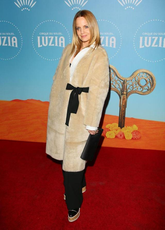 <p>The actress attended the Cirque Du Soleil <em>Luzia</em> red carpet in a teddy coat with a black bow. (Photo: Getty Images) </p>