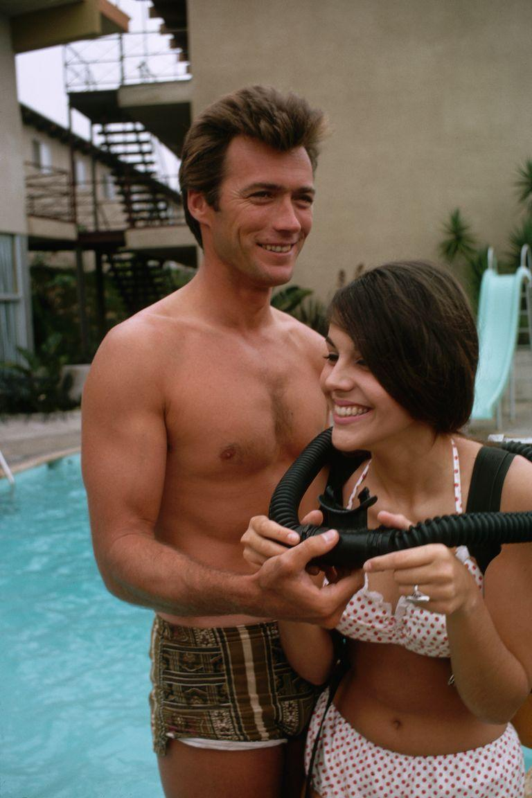 <p>Clint Eastwood pals around with a friend wearing a scuba pack at the pool in 1960. </p>