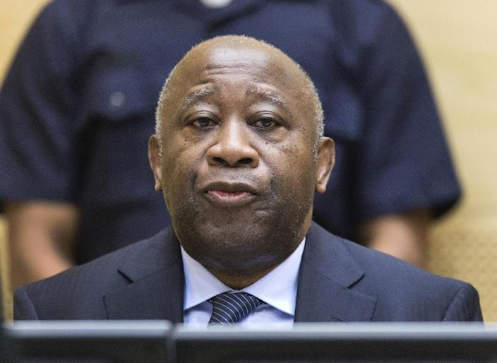 Former Ivory Coast President Laurent Gbagbo remains behind bars while prosecutors challenge a January 15 decision by the ICC to acquit him (AFP Photo/MICHAEL KOOREN)