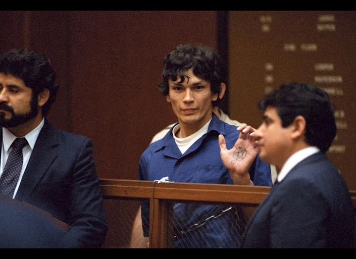 "In this file photo taken Oct. 24, 1985, ""Night Stalker"" Richard Ramirez displays a pentagram symbol on his hand inside a Los Angeles courtroom. The California Supreme Court Monday< Aug. 7, 2006, upheld the convictions and death sentence for serial killer Richard Ramirez, the so-called ""Night Stalker"" whose killing spree terrorized the Los Angeles area in the mid 1980s. Ramirez, now 46, was sentenced to death in 1989 for 13 Los Angeles-area murders committed in 1984 and 1985. Satanic symbols were left at some murder scenes and some victims were forced to ""swear to Satan"" by the killer, who broke into homes through unlocked windows and doors. (AP Photo/Lennox McLendon)"