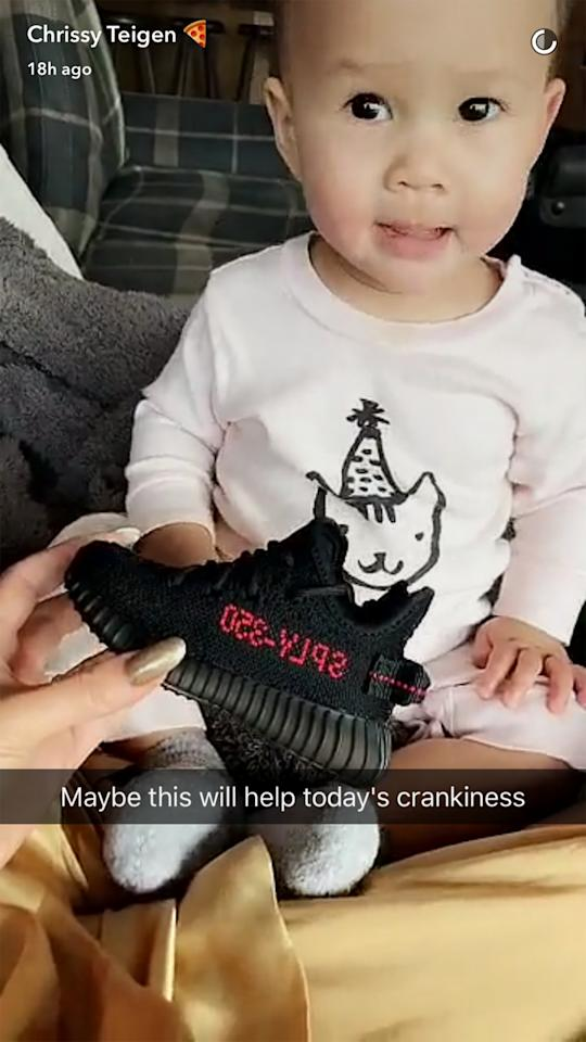 <p>Ten-month-old Luna Legend, the daughter of model Chrissy Teigen and singer John Legend, was gifted Yeezy sneakers on Valentine's Day by Kim Kardashian and her children North and Saint West. Chrissy posted a sweet image of her daughter on Snapchat with the gift. (Photo: Chrissy Teigen/Snapchat) </p>