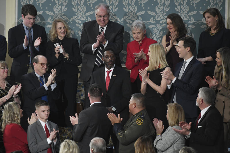 Tony Rankins receives a standing ovation during the State of the Union address to a joint session of Congress on Capitol Hill in Washington.