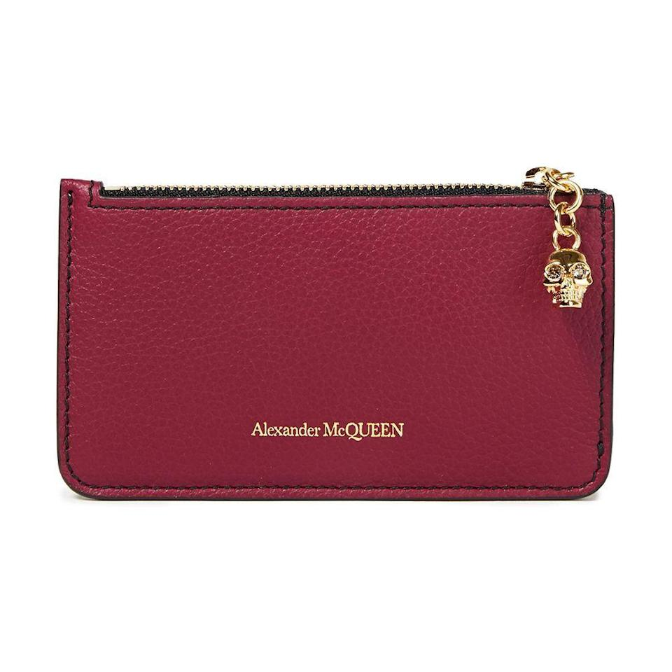 """<p><strong>ALEXANDER MCQUEEN</strong></p><p>theoutnet.com</p><p><a href=""""https://go.redirectingat.com?id=74968X1596630&url=https%3A%2F%2Fwww.theoutnet.com%2Fen-us%2Fshop%2Fproduct%2Falexander-mcqueen%2Fwallets%2Fpouches%2Fpebbled-leather-cardholder%2F10163292708405694&sref=https%3A%2F%2Fwww.cosmopolitan.com%2Fstyle-beauty%2Ffashion%2Fg35702755%2Fthe-outnet-semi-annual-sale%2F"""" rel=""""nofollow noopener"""" target=""""_blank"""" data-ylk=""""slk:Shop Now"""" class=""""link rapid-noclick-resp"""">Shop Now</a></p><p><strong><del>$350</del> $157 (55% off)</strong></p>"""
