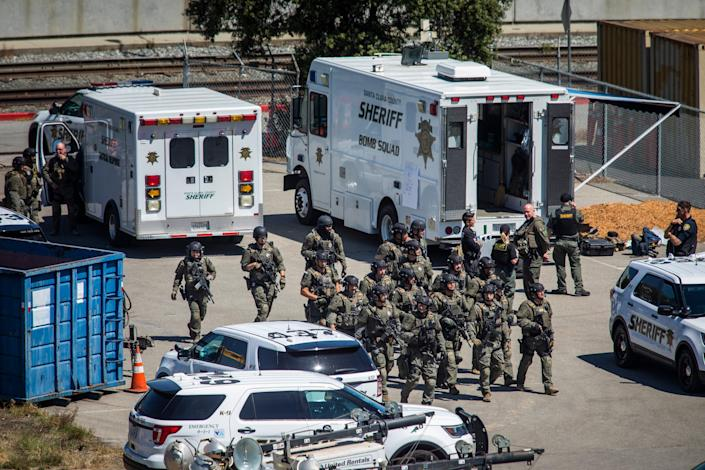 Tactical law enforcement officers move through the Valley Transportation Authority (VTA) light-rail yard where a mass shooting occurred on May 26, 2021 in San Jose, California (Getty Images)