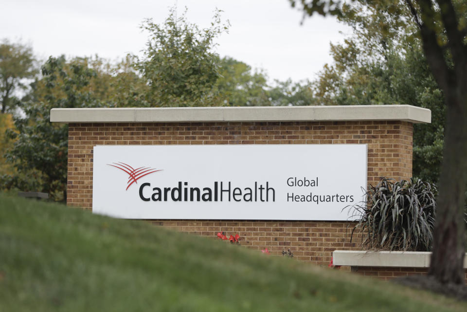 FILE - In this Wednesday, Oct. 16, 2019, file photo, a sign is displayed at the Cardinal Health, Inc. corporate office, in Dublin, Ohio. Four companies say they'll move ahead with a $26 billion settlement of lawsuits over the opioid crisis. An announcement from drug distributors AmerisourceBergen, Cardinal Health and McKesson came Saturday, Sept. 4, 2021. (AP Photo/Darron Cummings, File)