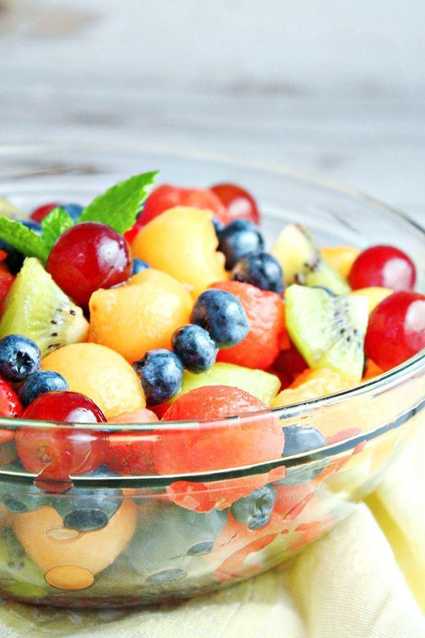 """<p>For a simple and fresh vegan side, toss together this fruit salad. It may look like your standard recipe, but don't be fooled: This one stands out, thanks to a rum-based mint dressing that tastes a lot like a true mojito. </p><p><a href=""""https://homecookingmemories.com/easy-mojito-fruit-salad-recipe/"""" rel=""""nofollow noopener"""" target=""""_blank"""" data-ylk=""""slk:Get the recipe."""" class=""""link rapid-noclick-resp"""">Get the recipe. </a></p>"""