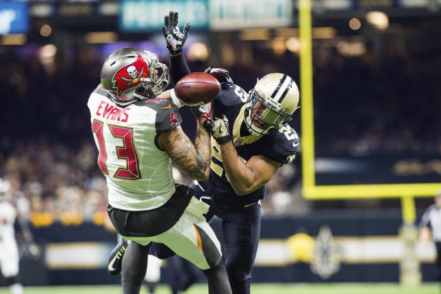 Mike Evans is going to sit out a game for his hit on New Orleans' Marshon Lattimore. (AP)