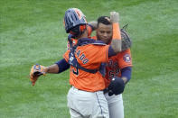 Houston Astros pitcher Framber Valdez, right, and catcher Martin Maldonado celebrate as the Astros beat the Minnesota Twins 4-1 in Game 1 of an American League wild-card baseball series, Tuesday Sept. 29, 2020, in Minneapolis. (AP Photo/Jim Mone)