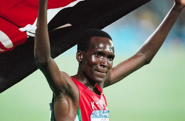 SYDNEY -  SEPTEMBER 25:  Paul Tergat of Kenya waves the Kenyan flag following his silver medal run in the Men's 10,000 meter race of the 2000 Olympics run on September 25, 2000 in the Olympic Stadium in Sydney, Australia.  (Photo by David Madison/Getty Images) (Photo: David Madison via Getty Images)