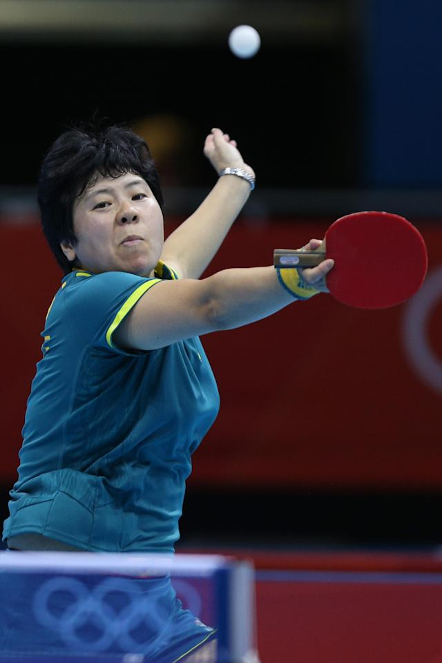 LONDON, ENGLAND - JULY 29: Jian Fang Lay of Australia plays a backhand in her Women's Singles second round match against Xue Li of France on Day 2 of the London 2012 Olympic Games at ExCeL on July 29, 2012 in London, England. (Photo by Feng Li/Getty Images)