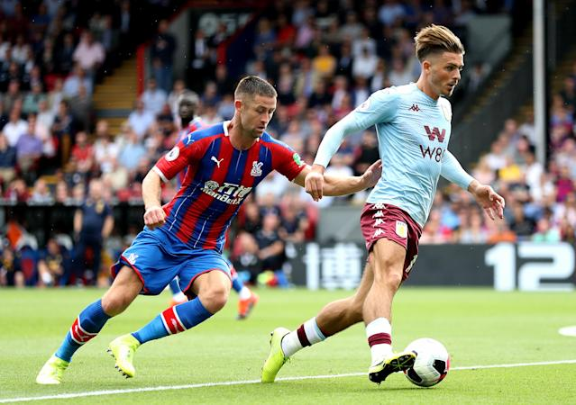Crystal Palace's Gary Cahill (left) and Aston Villa's Jack Grealish (right) battle for the ball (Picture: Getty)