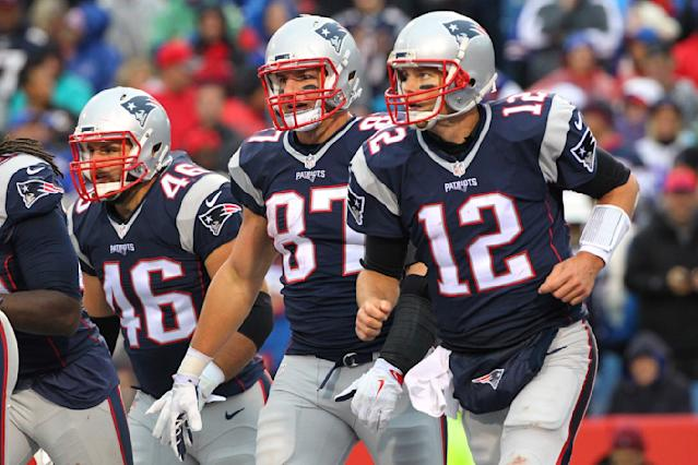 """FILE - In this Oct. 30, 2016, file photo, New England Patriots' Tom Brady (12), Rob Gronkowski (87) and James Develin (46) head back to the sideline after LeGarrette Blount scored a touchdown during the second half of the team's NFL football game against the Buffalo Bills in Orchard Park, N.Y. Gronkowski says he is retiring from the NFL after nine seasons. Gronkowski announced his decision via a post on Instagram Sunday, March 24, 2019, saying that a few months shy of this 30th birthday """"its time to move forward and move forward with a big smile."""" (AP Photo/Bill Wippert, File)"""