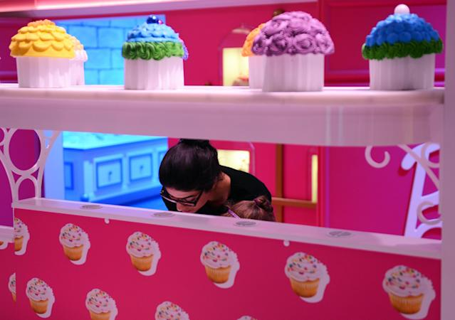 The pink kitchen is pictured with cupcakes in the Barbie Dreamhouse Experience near Alexanderplatz square in Berlin, Germany, Thursday May 16, 2013. The 2,500 square meter Barbie Dreamhouse Experience will be open for three months in Berlin. (AP Photo/dpa, Jens Kalaene)
