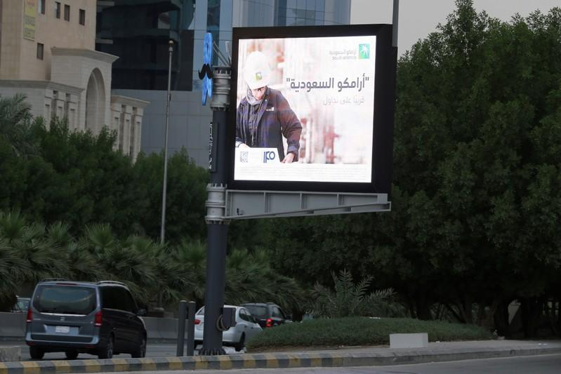 FILE PHOTO: A billboard display an advert for Saudi Aramco in the streets in Riyadh
