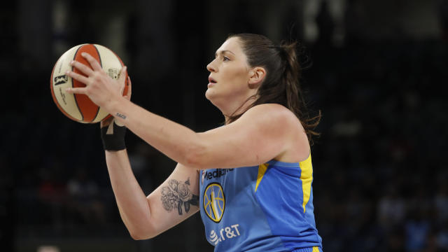 FILE - In this Aug. 16, 2019, file photo, Chicago Sky's Stefanie Dolson shoots during the first half of the team's WNBA basketball game against the Los Angeles Sparks in Chicago. It's been a busy week for Dolson. She was part of the NBA All-Star festivities this past weekend in Chicago as well as being selected to the USA Basketball 3-on-3 qualifying team. The All-Star center also re-signed with the Sky. The free agent said that she never considered going anywhere else and always wanted to stay in Chicago. (AP Photo/Charles Rex Arbogast, File)