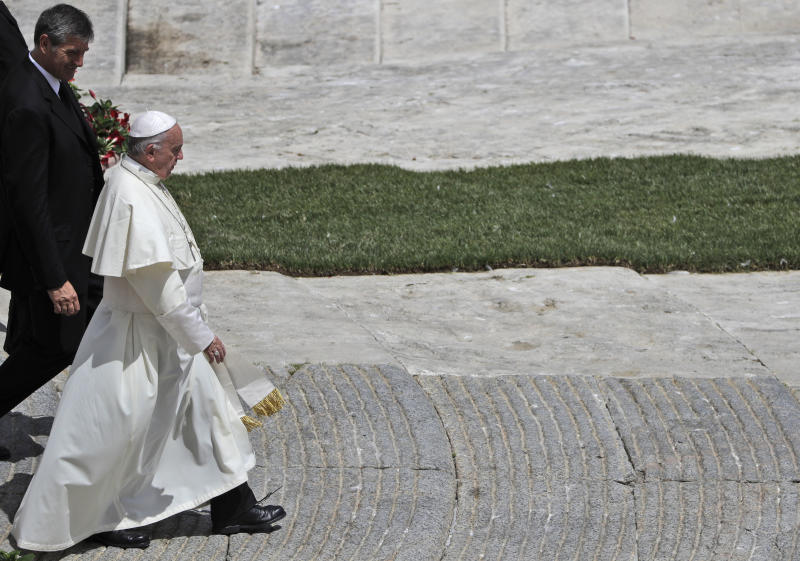Pope Francis leaves with his butler Sandro Mariotti, at the end of a special mass for Roman holiday of St. Peter and St. Paul in St. Peter's square at the Vatican, Thursday, June 29, 2017. (AP Photo/Gregorio Borgia)