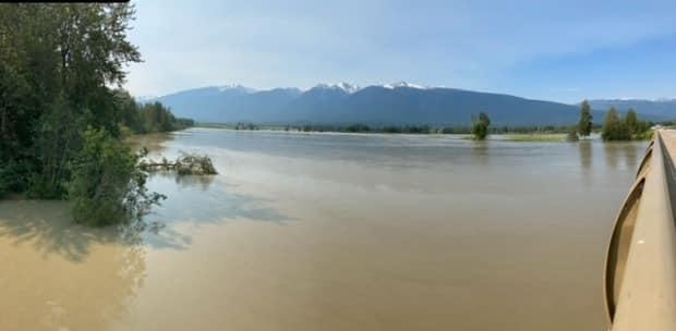 The Fraser River rises beneath the Highway 16 bridge near McBride on Wednesday morning. Officials say the bridge is not at risk. (Submitted by Ministry of Transportation, McBride office - image credit)