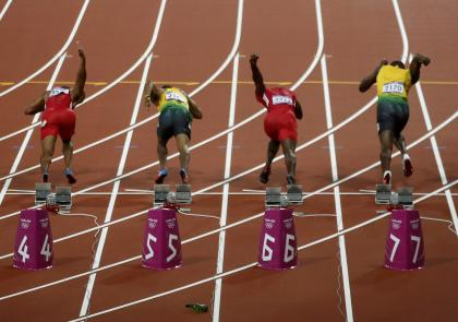 A beer bottle bounces on the track as competitors in the men's 100 meters final start off the blocks at the London 2012 Olympic Games August 5, 2012. (REUTERS/Paul Hanna)
