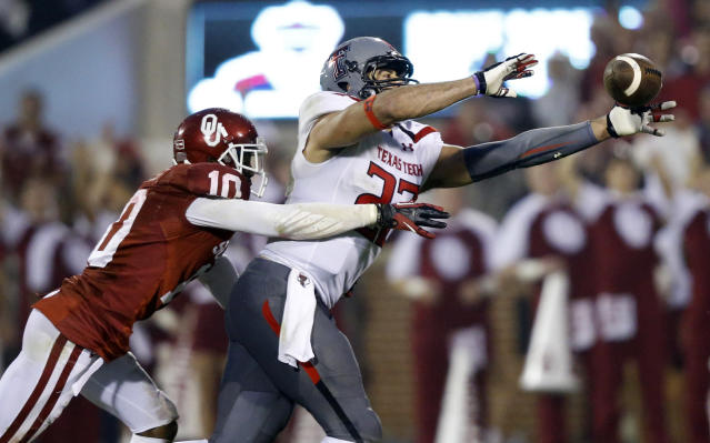 Oklahoma defensive back Quentin Hayes (10) defends as Texas Tech tight end Jace Amaro (22) reaches for a pass in the fourth quarter of an NCAA college football game in Norman, Okla., Saturday, Oct. 26, 2013. Oklahoma won 38-30. (AP Photo/Sue Ogrocki)
