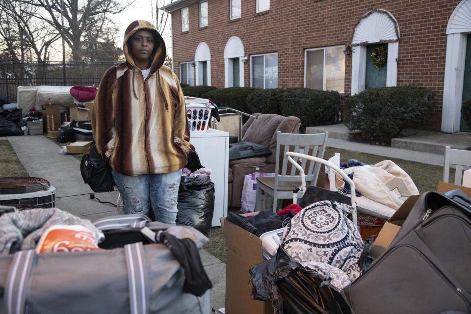 COLUMBUS, OH - MARCH 02:  Tiffany Padgett, 45, of Columbus, Ohio, poses watching items left by her neighbor, Shanta Thomas, who was evicted on March 2, 2021 in Columbus, Ohio. Padgett did not agree with the eviction, and wanted to help keep track of her neighbor's belongings. (Photo by Stephen Zenner/Getty Images)