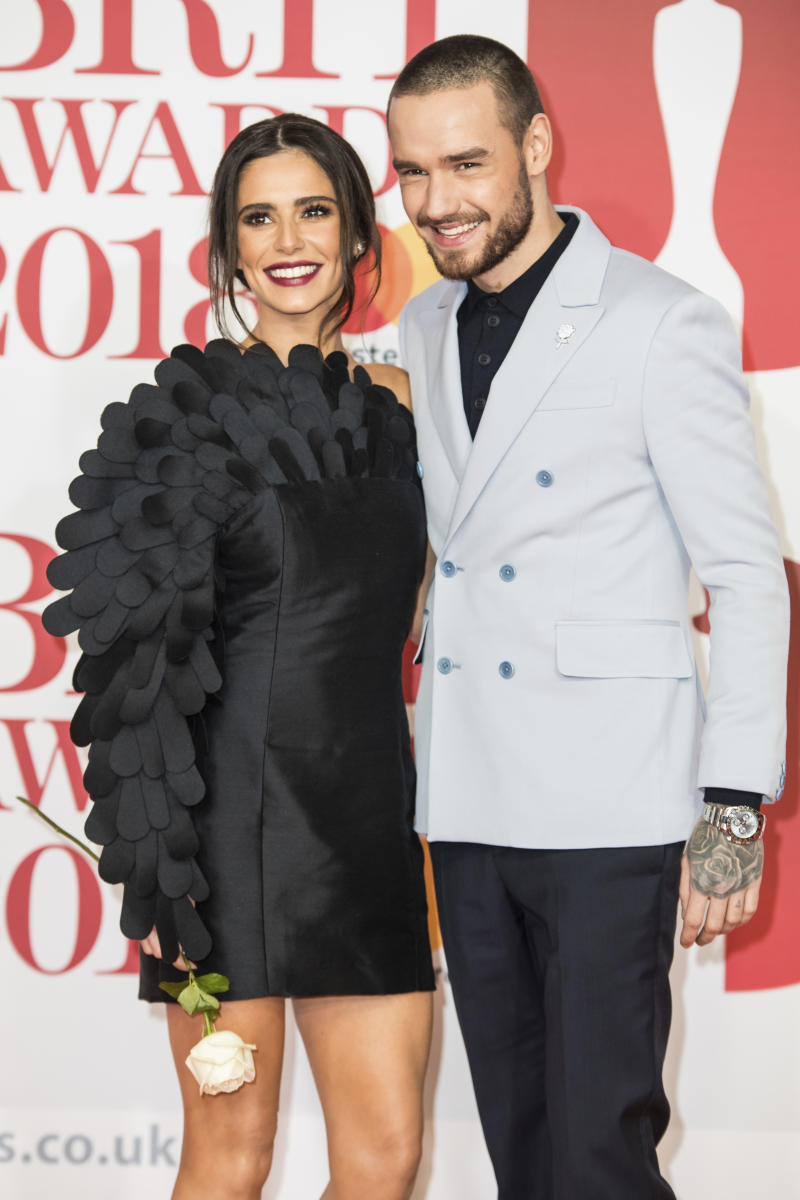 Singers Cheryl, left, and Liam Payne pose for photographers upon arrival at the Brit Awards 2018 in London, Wednesday, Feb. 21, 2018. (Photo by Vianney Le Caer/Invision/AP)