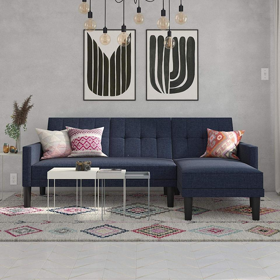 "<p>We love the modern, midcentury look of this <a href=""https://www.popsugar.com/buy/DHP-Haven-Sectional-Futon-Sofa-419754?p_name=DHP%20Haven%20Sectional%20Futon%20Sofa&retailer=amazon.com&pid=419754&price=380&evar1=casa%3Aus&evar9=46854177&evar98=https%3A%2F%2Fwww.popsugar.com%2Fhome%2Fphoto-gallery%2F46854177%2Fimage%2F46854530%2FDHP-Haven-Sectional-Futon-Sofa&list1=amazon%2Cfurniture%2Cshoppping%2Csmall%20space%20living%2Chome%20shopping&prop13=mobile&pdata=1"" rel=""nofollow"" data-shoppable-link=""1"" target=""_blank"" class=""ga-track"" data-ga-category=""Related"" data-ga-label=""https://www.amazon.com/DHP-Haven-Small-Space-Sectional/dp/B07H6CTP93/ref=sr_1_32?keywords=sofas+under+350&amp;qid=1552080725&amp;s=gateway&amp;sr=8-32"" data-ga-action=""In-Line Links"">DHP Haven Sectional Futon Sofa</a> ($380).</p>"